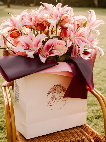 Flower bag arranged with flowers, roses, lylies and mixed flowers